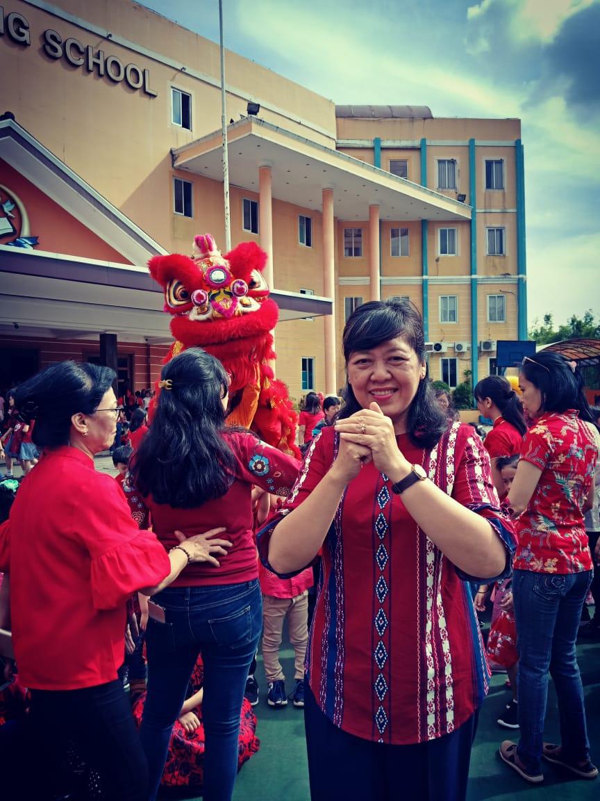 Dra Tan Minggayani, M.Ag