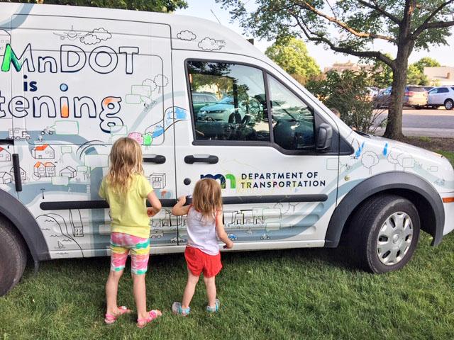 Kids drawing on a MnDOT engagement vehicle.